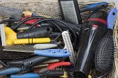 picture of grooming  - Used tools and supplies for dog grooming are in knitted basket - JPG