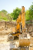 stock photo of excavator  - The excavator working on a construction site - JPG