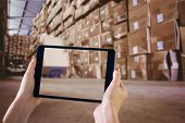 picture of pallet  - Finger pointing to tablet against worker with fork pallet truck stacker in warehouse - JPG