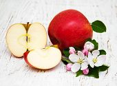 pic of apple blossom  - apples and apple tree blossoms on a wooden background - JPG