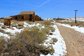 stock photo of sagebrush  - Sagebrush and snow taken in an abandoned mining old west ghost town called Bodie - JPG