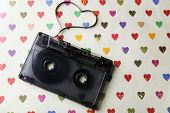 image of magnetic tape  - Audio cassette with magnetic tape in shape of heart on paper background - JPG
