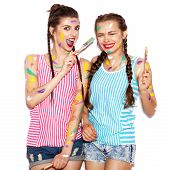 picture of crazy face  - Paint on the face of smiling girl friends having fun - JPG