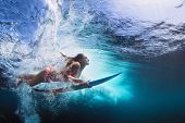 Underwater Photo Of Girl With Board Dive Under Ocean Wave poster