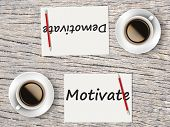 Business Concept : Comparison Between Motivate And Demotivate poster