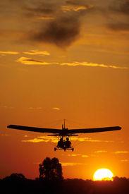 pic of ultralight  - two pilots fly in an ultralight plane - JPG