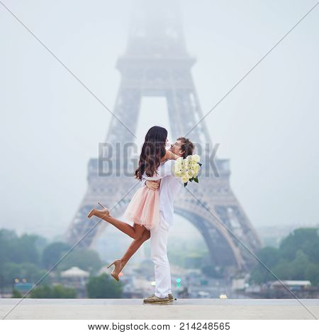 poster of Happy Couple Near The Eiffel Tower