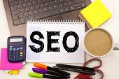 Seo Search Engine Optimization Text In The Office With Surroundings Such As Laptop, Marker, Pen, Sta poster