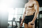 Handsome Model Young Man Training Abs In Gym poster