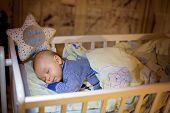 Adorable Newborn Baby Boy, Sleeping In Crib At Night poster