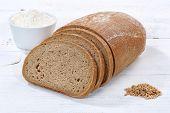 Wheat Bread Slice Slices Sliced Loaf On Wooden Board poster