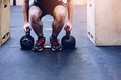 Man Pulling Kettlebells Weights In The Functional Fitness Gym poster