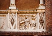 image of armorial-bearings  - Old balcony with colums and emblem  - JPG