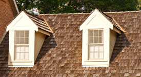 stock photo of gabled dormer window  - Two windows in dormers on a wood shingle roof - JPG