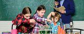 Chemistry Lab. Back To School. Happy Children Teacher. Kids In Lab Coat Learning Chemistry In School poster
