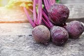 Organic Beetroot Vegetable / Fresh Red Beet Roots Harvested On Wooden Background poster