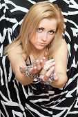 Pretty Woman Stretches Out Her Hands In Chains