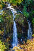 The small Croatian town of Slunj. The forest surround the river. Cascade of waterfalls on the river. poster