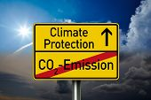 Traffic Sign With Climate Protection, Co2 Emission And Co2 Tax With Clouds In The Background poster