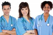image of medical staff  - Team of young doctors a over white background - JPG
