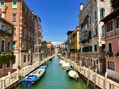 An Incredible Beautiful View Of A Canal In Venice, Italy On A Bright Summer Day.  The Canal Is Lined poster