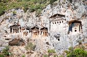 pic of dalyan  - ruins of Lycian rock tombs seen from Dalyan River near ancient city Kaunos in Turkey - JPG