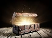 Treasure Chest - Open Ancient Trunk With Glowing Magic Lights In The Dark poster