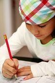 picture of school child  - Young girl working on assignment at school - JPG