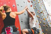 Couple Of Athletes Climber Moving Up On Steep Rock, Climbing On Artificial Wall Indoors. Extreme Spo poster
