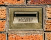 Retro Mailbox Wall Mounted. Postbox For Letters. Red Brick Wall On Background poster