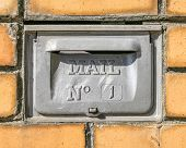Retro Mailbox Wall Mounted. Postbox For Letters With Number One. Yellow Brick Wall On Background poster