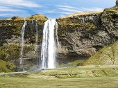 View Of Skogafoss Iceland Waterfall In Spring Season poster