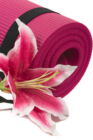 stock photo of yoga mat  - Yoga mat and a beautiful lily on white background - JPG