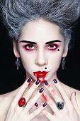 foto of marquise  - Portrait of young beautiful stylish gothic woman with vintage hairdo and bloody mouth - JPG