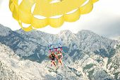 picture of parasailing  - two young girls parasailing over adriatic watres in Croatia - JPG