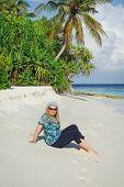 pic of kuramathi  - Young woman on white sand beach on Maldivian island - JPG