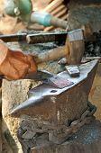stock photo of blacksmith shop  - Forging a hammer head in a traditional blacksmith shop Cambodia - JPG
