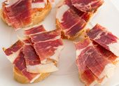 Spanish tapas, ham and tomato