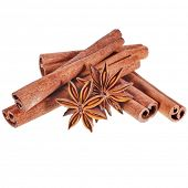 cinnamon sticks with whole star anise isolated on white background