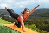 Young Woman Practicing Yoga In Mountain