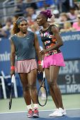 Grand Slam champions Serena Williams and Venus Williams during doubles match at US Open 2013