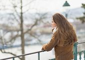 Happy Young Woman In Winter Park Looking Into Distance