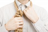 stock photo of gallows  - Businessman wearing gallow rope over his neck - JPG
