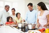 foto of 70-year-old  - Multi Generation Indian Family Cooking Meal At Home - JPG