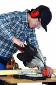 Man using a miter saw