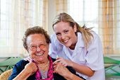 foto of geriatric  - a nurse home care visits a patient - JPG