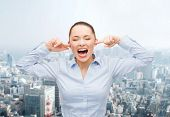 business, office and stress concept - angry screaming businesswoman outdoors