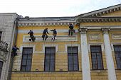 Repair Of The Facade Of A Historic Building Migrant Workers