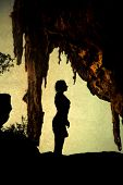 image of cave woman  - Woman silhouette in cave  - JPG