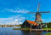 picture of holland flag  - Picturesque rural landscape with windmills in Zaanse Schans close to river Holland Netherlands - JPG